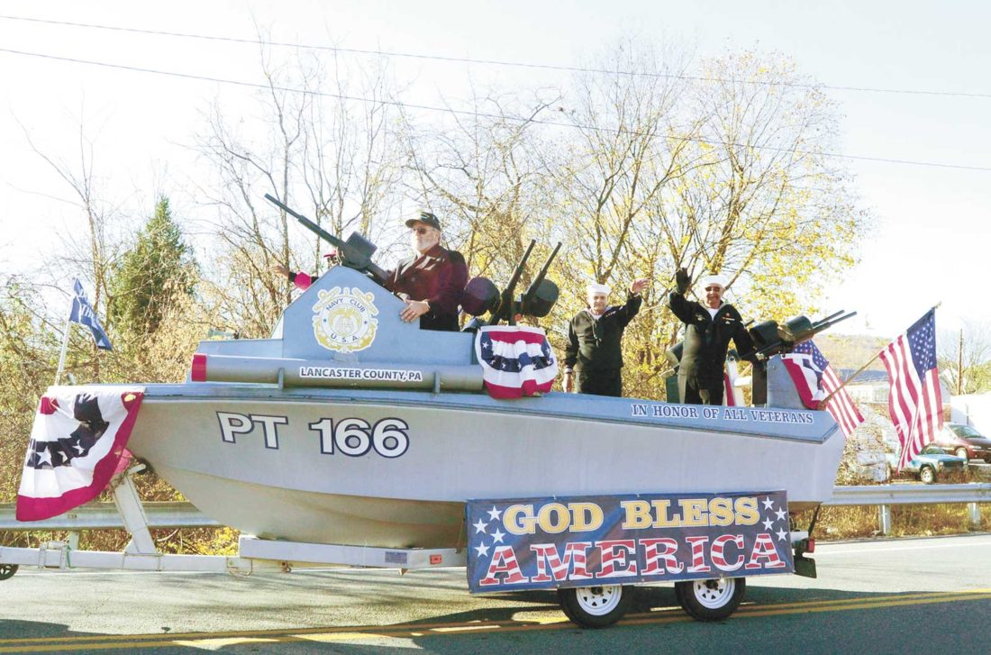 "The Lancaster, PA Navy Club of the United States of America, ""Chartered by Congress 1940"" of the Coast Guard, Marines, and Navy ship PT 166 came out for the Veterans Day Parade. From left, Jim Pearson, Don Christ, and Walter King.   Sentinel photo by TIM  SHUMAKER"