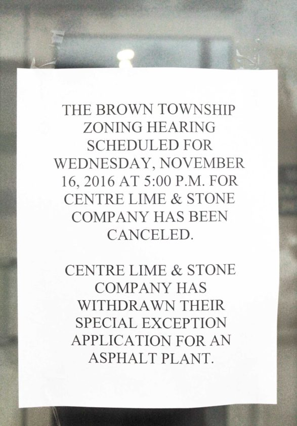 This sign was placed on the entrance of the rental hall of the Reedsville Fire Co. Wednesday night, notifying people of a canceled meeting of the Brown Township Zoning Hearing Board regarding the proposed asphalt plant in Brown Township.  Sentinel photo by LAUREN KERSHNER