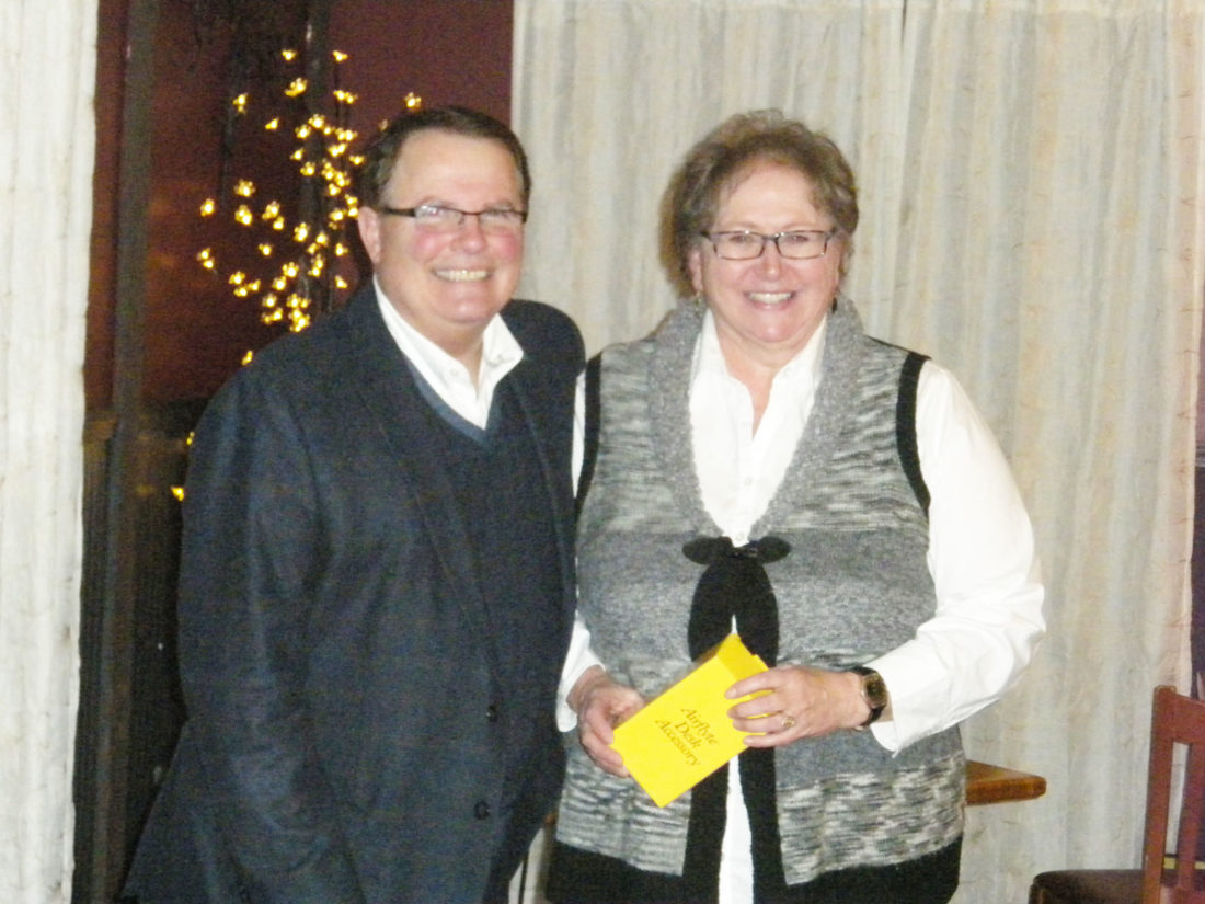Submitted photo Teresa Ellinger is pictured receiving her award for 20 years of  dedicated service to Penn State Juniata County's 4-H program from Thomas Walker, Penn State Extension District 13 Director.