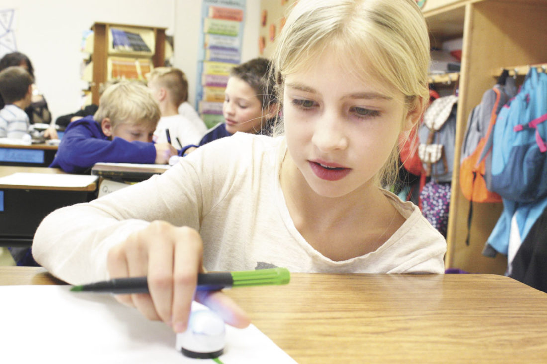 Student Chantel Weaver controls a robot during the Belleville Mennonite School fifth grade informative learning experience with Eric Yoder from the Tuscarora Intermediate Unit Tuesday afternoon, in Belleville. The students learned about STEM (science, technology, engineering and mathematics) fields with an Ozobot. The presentation included instruction on the basic coding concepts for controlling robots.  Photo submitted by VALERIE REED