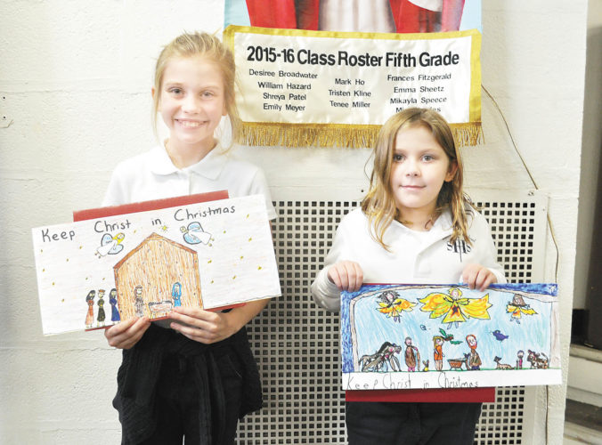 Photo submitted by ASHLEY HENRY Addie Wilburne, left, and Elena Colon were chosen as the Knights of Columbus 'Keep Christ in Christmas' Billboard Design Contest. Each design will be displayed on a billboard across Mifflin County.