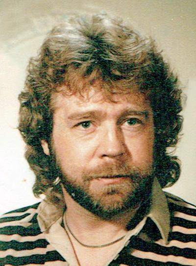 Dennis E. Moore