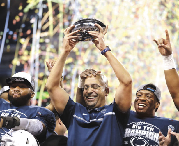 AP photo Penn State head coach James Franklin holds the trophy after Penn State won the Big Ten Championship NCAA college football game  Saturday in Indianapolis.