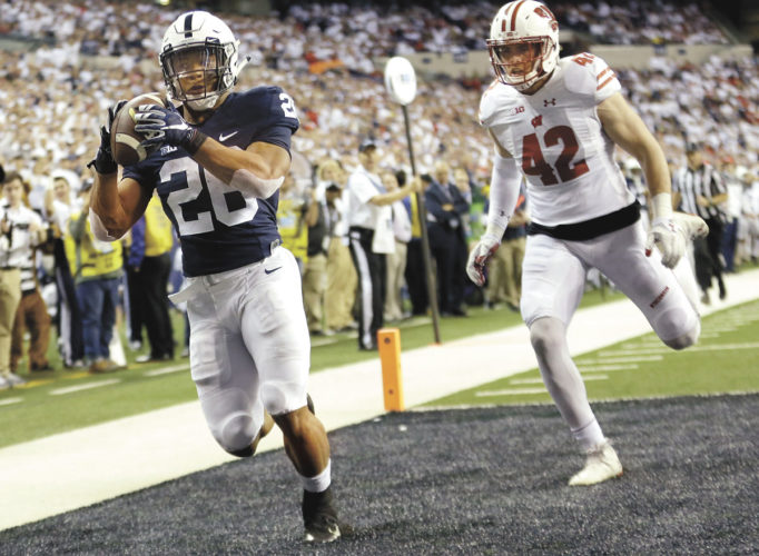AP photo Penn State's Saquon Barkley (26) makes an 18-yard touchdown catch against Wisconsin's T.J. Watt (42) during the second half of the Big Ten Championship NCAA college football game Saturday.