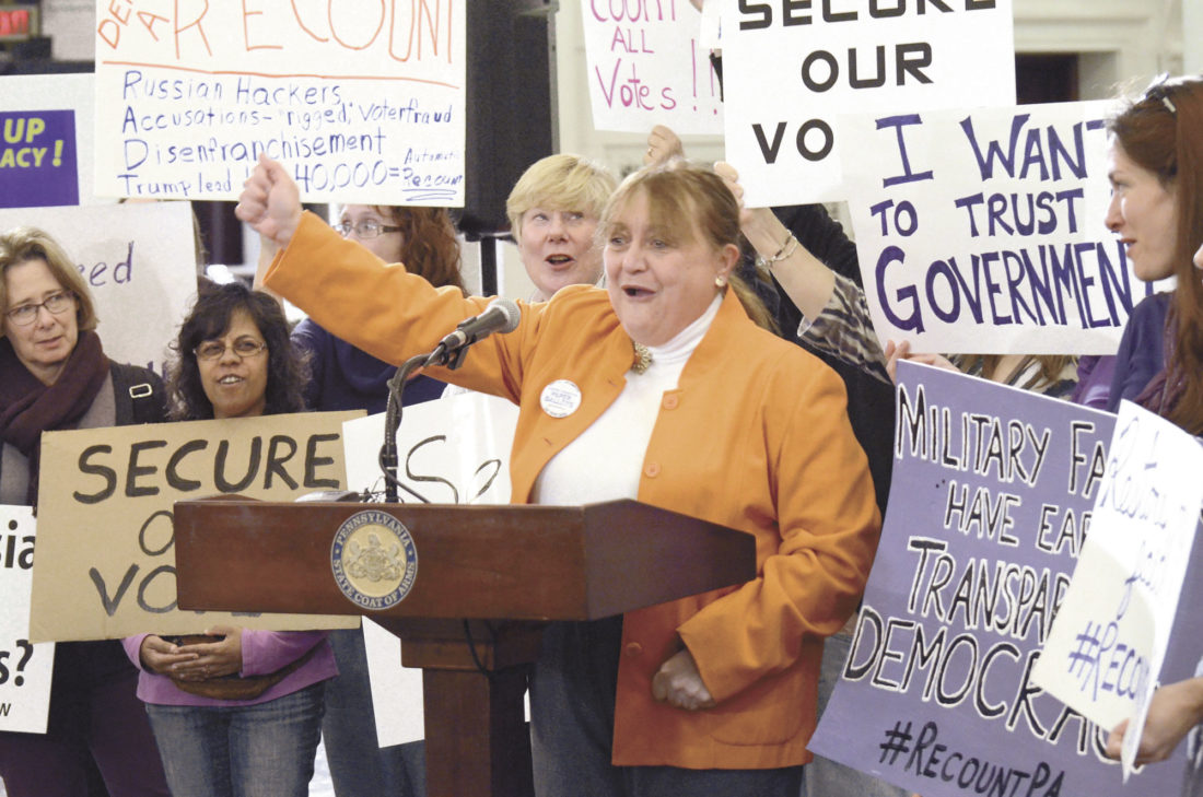 AP photo Marybeth Kuznik, center, of VotePA, an election integrity advocacy group, leads a rally Monday at the Pennsylvania Capitol in support of a Green Party-backed quest for a recount of Pennsylvania's Nov. 8 presidential election, in Harrisburg.