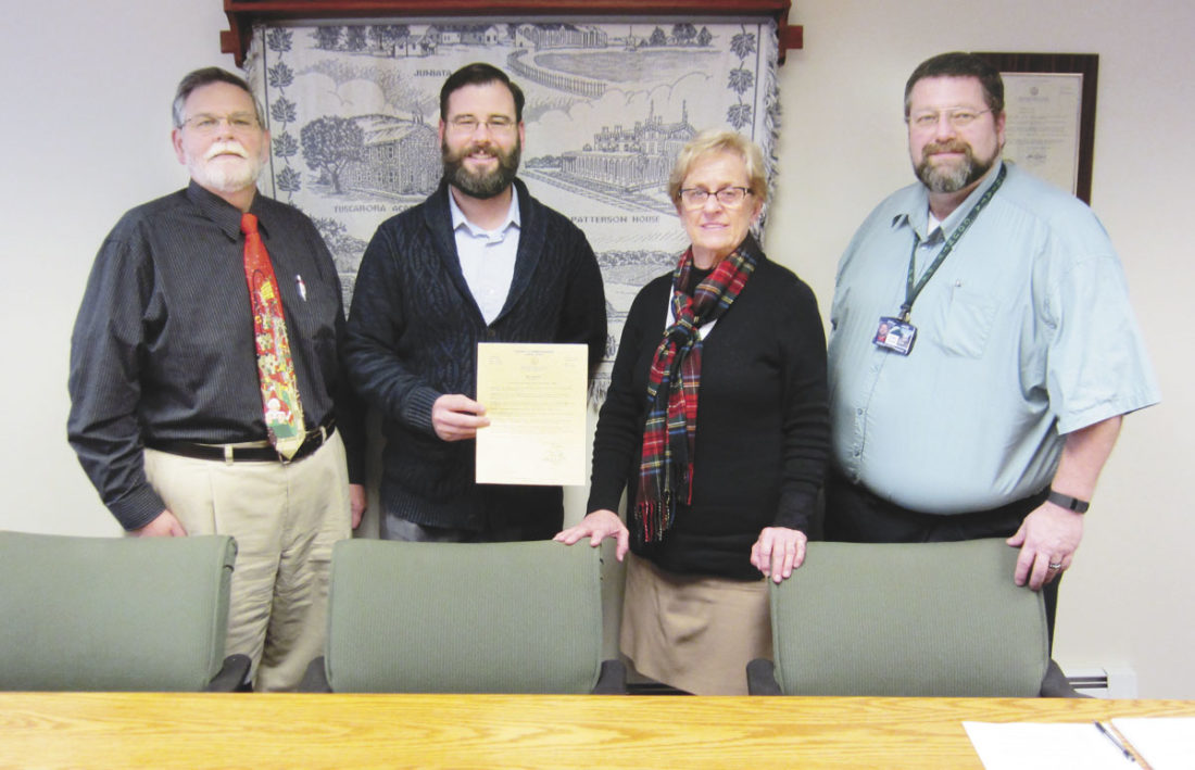 Sentinel photo by JOE CANNON The Juniata County Commissioners on Tuesday adopted a proclamation designating December as 'United Way Month.' Participating in the proclamation ceremony were, from left, Mark Partner, commissioner; Mike McMonigal, executive director of the United Way of Mifflin- Juniata; Alice Gray commissioner; and Todd Graybill, commissioner.