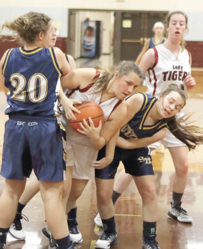 Sentinel photo by MATTSTRICKER East Juniata's Erin Heimbach (21), center, wrestles the ball away from Southern Huntingdon defenders McKenzie Yohn (20) and Hanna Booher Friday in Cocolamus.