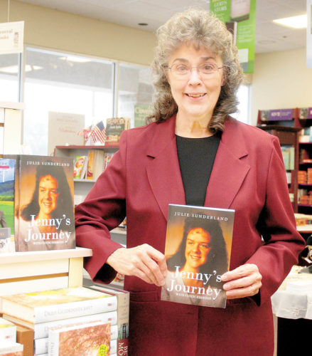 Sentinel photo by BUFFIE BOYER Julie Sunderland displays her new book about her daughter at Friendship Bookstore in Burnham.