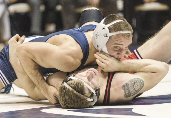 Sentinel photo by FRANK DIMON Penn State's Zain Retherford, top, pinned Rutgers' Kenny Theobald at 149 pounds Friday night at Rec Hall.