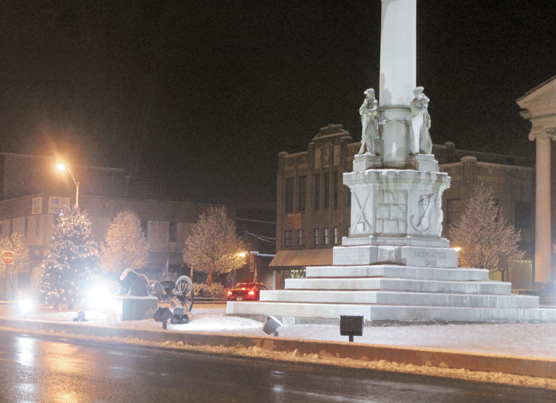Sentinel file photo  Shown is a view of Monument Square from East Market Street during the first snow fall of the winter in Downtown Lewistown. PennDOT announced Tuesday funding for Phase V of the Monument Square streetscape project.