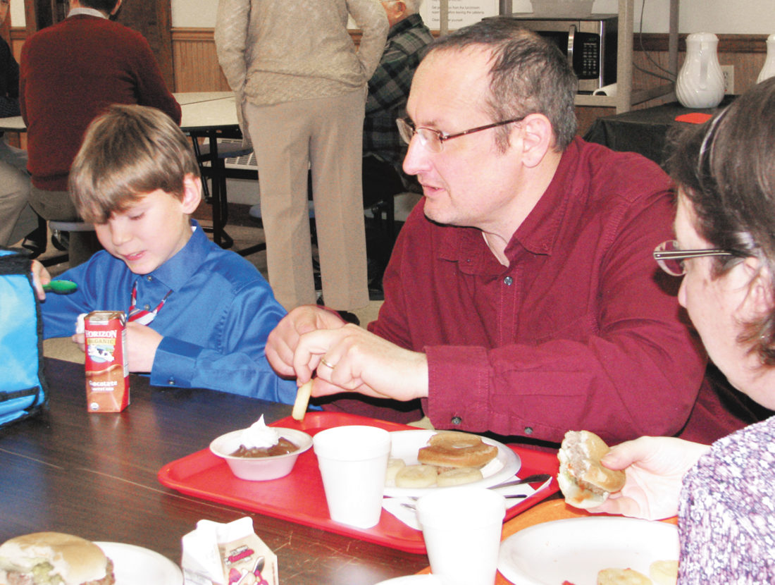 Sentinel photo by TABITHA GOODLING  Pastor Jesse Bingaman, of Ebenezer Bible Church in Mt. Pleasant Mills, gets to know fifth grader Chaz Auker during lunch.  Pastor's Day was celebrated at Juniata Mennonite School on Wednesday as part of Spiritual Renewal Week. Pastors from  Juniata, Perry and Snyder counties attended students' classes and enjoyed lunch with their parishioners and news faces.