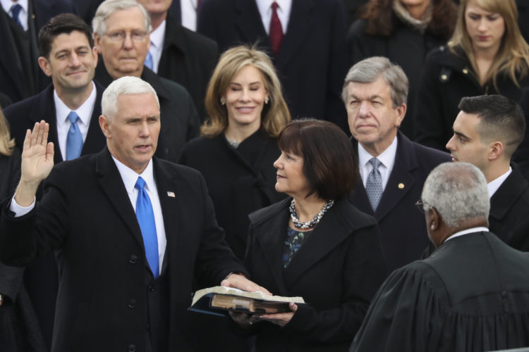 Vice President Mike Pence is sworn in by Justice Clarence Thomas as this wife Karen holds the bible during the 58th Presidential Inauguration at the U.S. Capitol in Washington, Friday, Jan. 20, 2017. (AP Photo/Andrew Harnik)