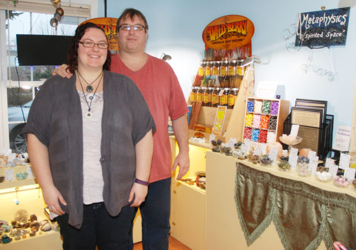 Sentinel photo by BUFFIE BOYER Lyndsey and Andy Hagerty welcome customers to their new business, Metaphysics 'A Spirited Place,' a holistic wellness center in Lewistown.