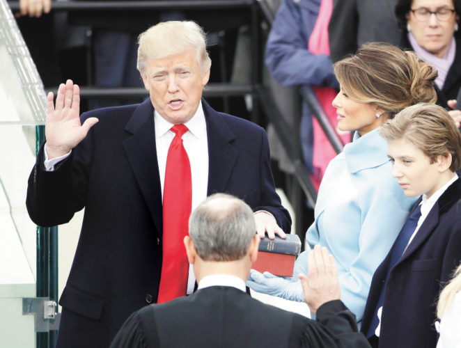 AP photo Donald Trump is sworn in as the 45th president of the United States by Chief Justice John Roberts, Friday, as Trump's wife Melania and Trump's son Barron look on during the 58th Presidential Inauguration at the U.S. Capitol in Washington.
