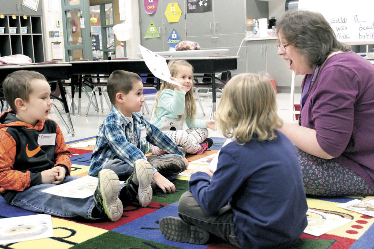 Sentinel photo by JULIANNE CAHILL Elaine Siddons, kindergarten teacher at Lewistown Elementary School, reviews the book 'The Mitten' with preschool-age children during a Kindergarten Readiness Workshop on Jan. 14 at the school.