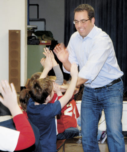 Sentinel file photo John Pannizzo, right, Sacred Heart of Jesus School alumnus, high fives students during Catholic Schools Week at the school in Lewistown.