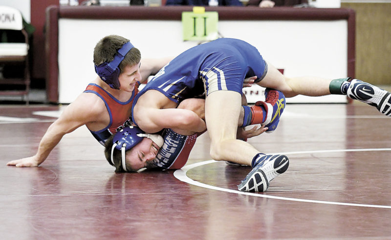 Sentinel photo  by JEFFFISHBEIN  Mount Union's Josh Boozel, top, works Cambria Heights' Allen Simmons in their semifinal in the District 6 Class 2A wrestling championships Saturday in Altoona. Boozel had four takedowns in a 13-2 major decision to reach the championship.