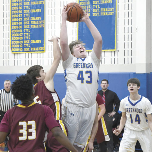 Sentinel photo by JEFF FISHBEIN  Greenwood's Austin Bower (43) goes for a jumper over Berks Christian's Jacob Weidner Monday in Millerstown. Looking on are the Lions' Isaiah Egziabher (33) and Greenwood's Isaac Shaw (14).