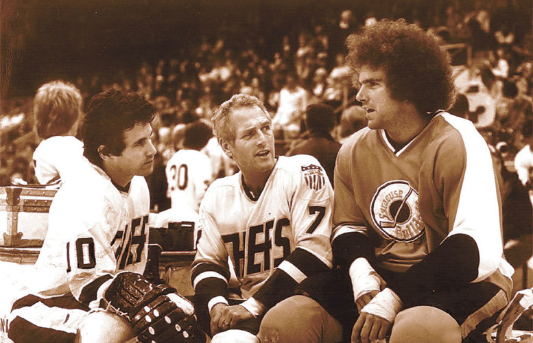 Photo courtesy The (Johnstown) Tribune-Democrat  Actors Michael Ontkean, left, Paul Newman, center, and Johnstown Jet Ned Dowd chat during a break in the filming of 'Slap Shot' at Cambria County War Memorial Arena in 1976. Johnstown will host a celebration of the sports film Saturday, the 40th anniversary of its release.