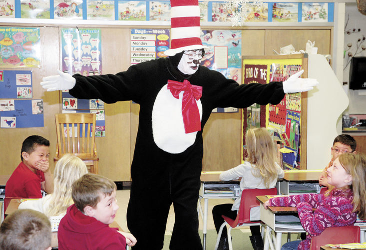 Sentinel photo by BUFFIE BOYER  The Cat in the Hat tells the first grade class at Mountain View Elementary School cat tales and the importance of reading during his visit to the school to celebrate Dr. Seuss' upcoming birthday on March 2.