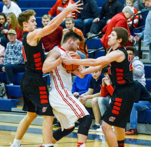 Sentinel photo by TAMI KNOPSNYDER Juniata's Bryson Clark fights for control of the ball with Central Cambria's Billy Davis as Central Cambria's Evan Bopp defends over the top Monday in Hollidaysburg.