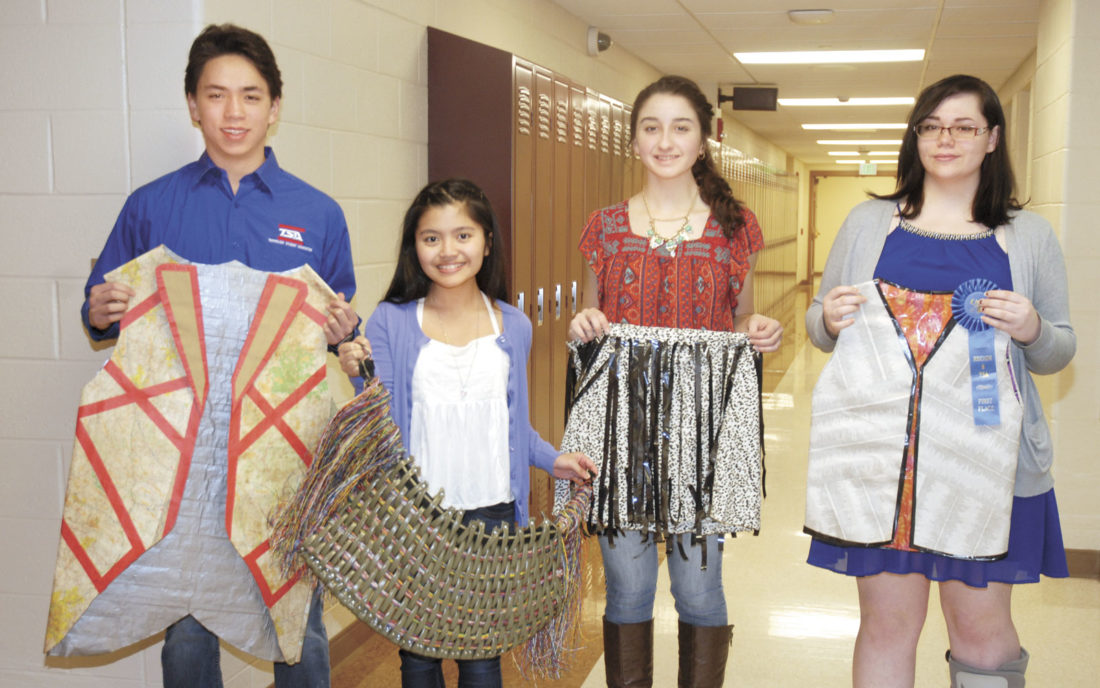 Sentinel photo by BUFFIE BOYER First place winners in Fashion Design and Technology from Mifflin County High School are, from left, Ian Shoemaker, Alyssa Humarang, Amber Schifano and Jerri McGuire.