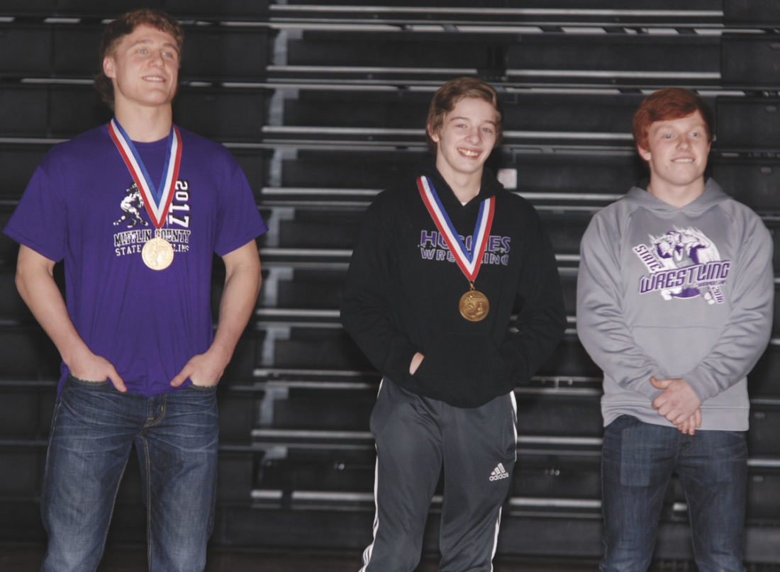 Sentinel photo by BRADLEY KREITZER  Trent Hidlay (left), Christian Fisher (center) and Noah Myers stand during a special presentation  honoring their success at the PIAA state wrestling tournament.