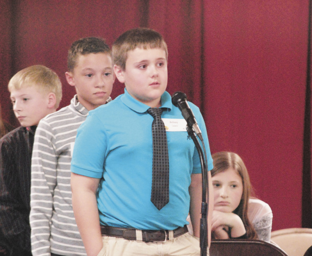 Sentinel photo by BRADLEY KREITZER  Anthony Catania, of Mifflin County Christian Academy, listens for his word during the annual Mifflin County Spelling Bee held at Sacred Heart of Jesus School in Lewistown. Catania went on to win this year's spelling bee, which featured students from both schools as well as Belleville Mennonite School.