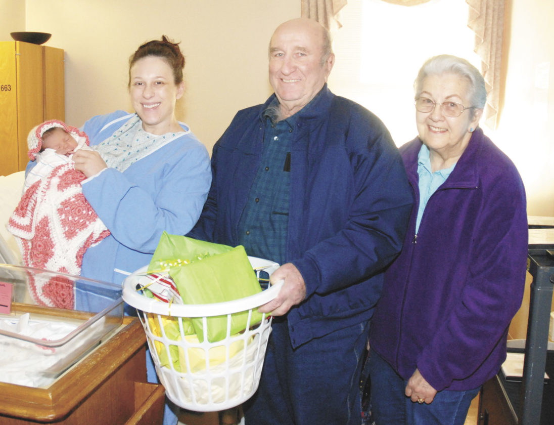 Sentinel photo by BUFFIE BOYER  Frank, center, and Barb Bonson, right, both from the Mifflin County Farm Bureau, present a basket of goodies to new mother, Tasha Parks and her daughter Madison Dudick in honor of the first baby born for National Ag Day. Dudick was born at 8:42 a.m. on Wednesday at Geisinger Lewistown  Hospital. Dudick's father is Matthew Dudick, absent from photo.