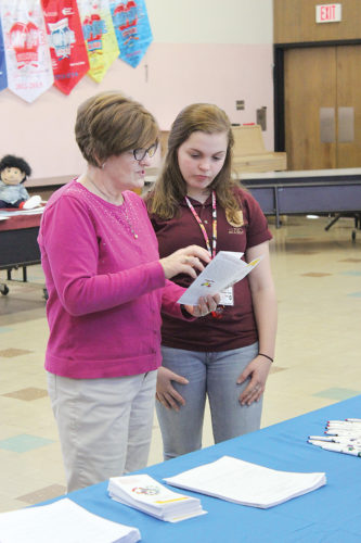 Sentinel photo by JULIANNE CAHILL  Cathy Dysinger, program operations manager for Juniata County Head Start, speaks with 10th grade student Morgan Fultz during a job fair held Thursday at Fermanagh-Mifflintown Elementary School.