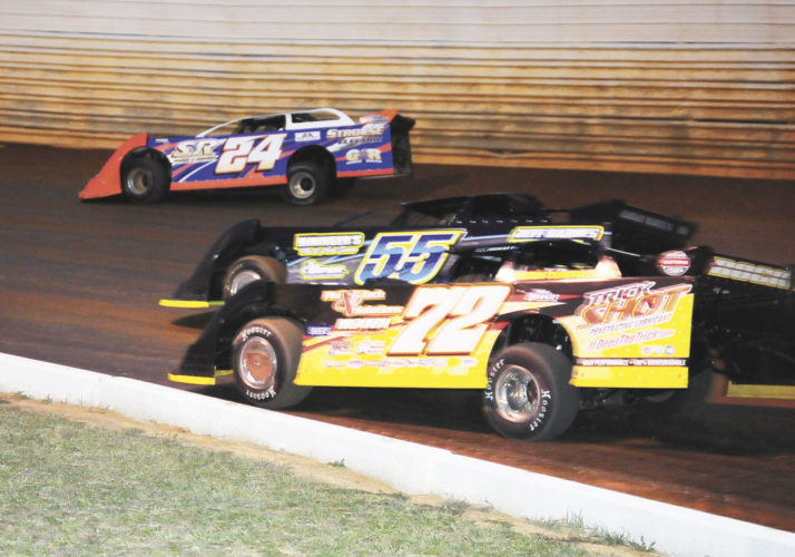 Sentinel photo by TIM SHUMAKER  Racing three-wide in the UFO late model feature Saturday at Port Royal Speedway is, Jason Covert (72), Gary Stuhler (55) and Dylan Yoder. Austrialian Lynton Jeffrey won the race.