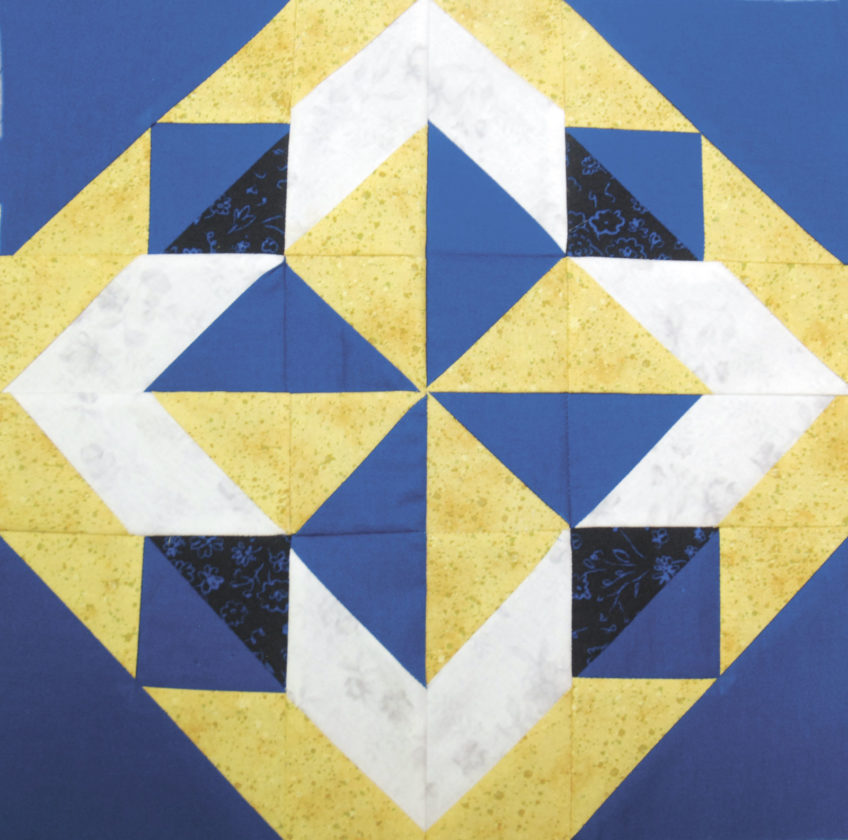 Sentinel photo by BUFFIE BOYER Joan Yoder created a quilt block using the FFA colors of blue and gold for the next quilt to be auctioned off at the Mifflin County Youth Fair in 2018. Yoder is asking for quilt block donations that feature the FFA colors.