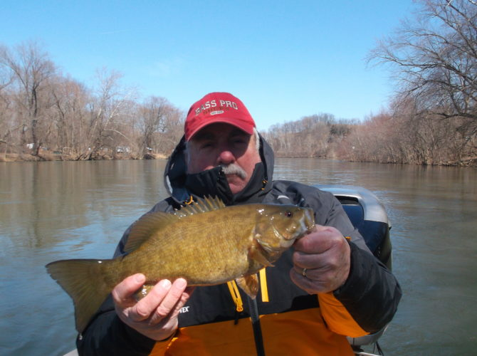 Sentinel file photo Being able to continue catching and releasing healthy smallmouth bass on the Juniata River — like this one that was taken while fishing with Shallow Water Guide Service and guide Jason Halfpenny of Lewistown — could depend on the actions taken on proposals being considered by the Pennsylvania Fish and Boat Commission board of commissioners.