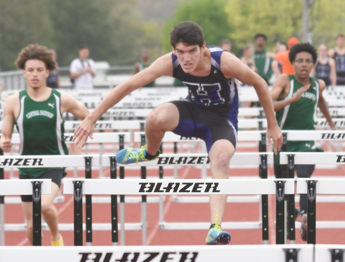 Sentinel photo by JEFFFISHBEIN The Huskies' Michael Tate leads in the boys 110-meter hurdles against Central Dauphin Thursday in Lewistown.