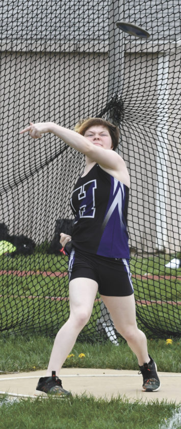 Sentinel photo by JEFFFISHBEIN Layla Shimp releases the discus in the Mifflin County girls meet against Central Dauphin. Shimp had a better throw in the shot put, which she won with a personal best effort.
