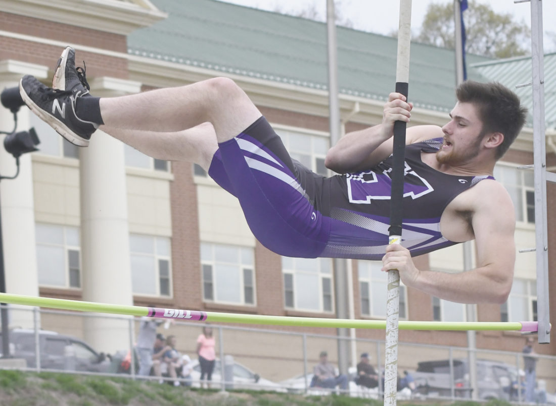 Sentinel photo by JEFFFISHBEIN Mifflin County's Scout Kyler clears the bar in the boys pole vault against Central Dauphin Thursday in Lewistown. Kyper helped the Huskies to a sweep of the event.