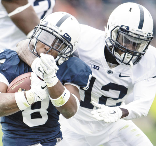 AP photo  Penn State running back Mark Allen, left, gets stopped by Desi Davis Saturday during the Penn State Blue-White game at Beaver Stadium.