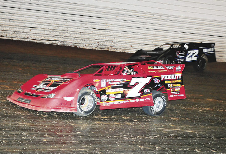 Sentinel photo by TIM SHUMAKER  Rick Eckert, left, leads Greg Satterlee out of turn one Sunday during the Lucas Oil Late Model Dirt Series race at Port Royal Speedway. Eckert won the race.