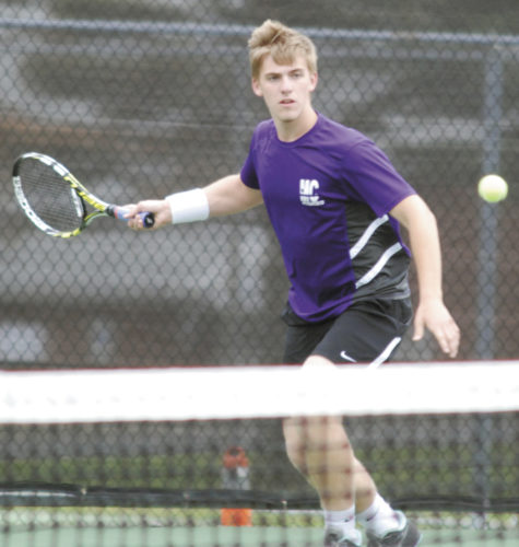 Sentinel photo by BUFFIE BOYER Mifflin County's John Hurlburt looks to return a ball in the Huskies' match against Hershey Tuesday.