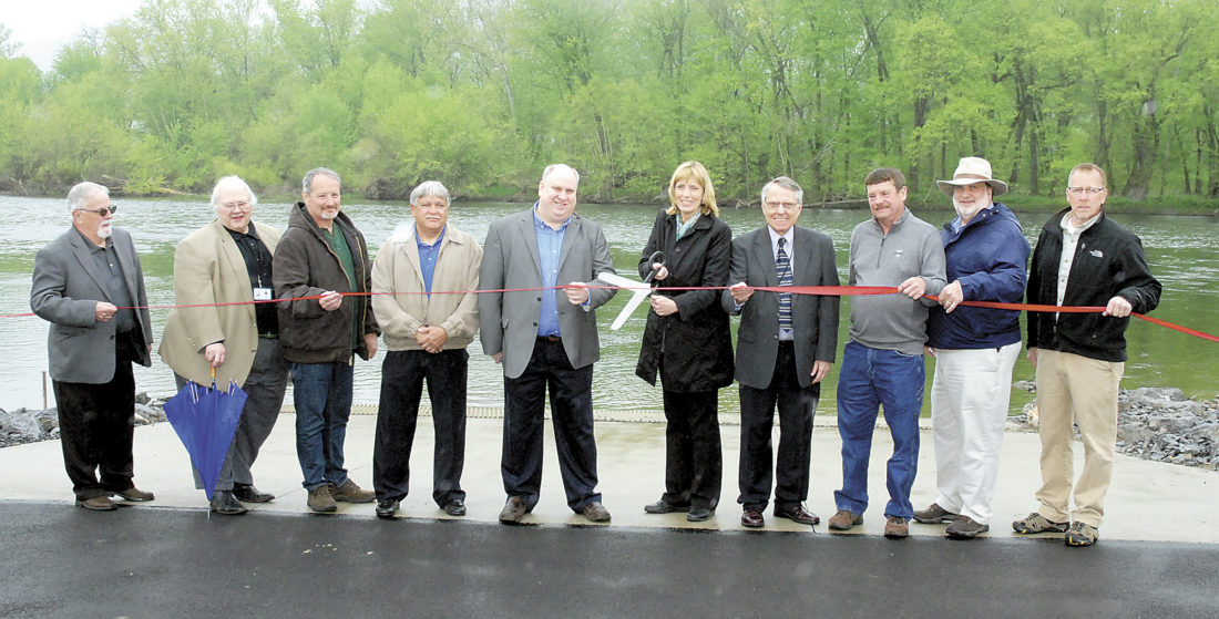 Sentinel photo by BUFFIE BOYER  Cutting the ribbon to open the Juniata River Boat Launch Tuesday near McVeytown are, from left, Otis Riden, former Mifflin County commissioner; Steve  Dunkle, Mifflin County commissioner; Mark Zong, McVeytown Borough; Steve  Feathers, McVeytown Borough president; Kevin Kodish, Mifflin County commissioner; Cindy Adams Dunn, Department of Conservation and Natural Resources; Bill Gomes, Mifflin County Planning and Development Department; Stan Collins, Bratton Township; Robert Campbell, National Park Service; and Lonnie Griffith, Bratton Township.