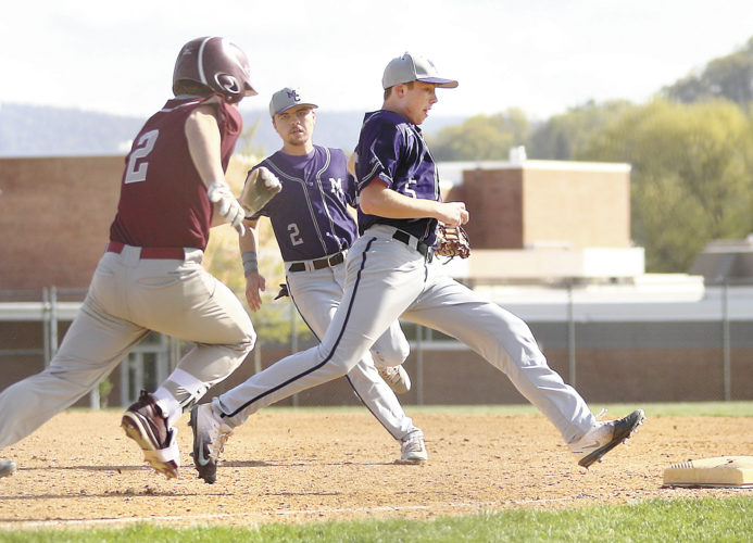 Sentinel photo by MATT STRICKER  Mifflin County first baseman Kevin Walker, right, races to first for the unassisted putout after fielding a grounder by State College batter Liam Clarke, left, Wednesday in Lewistown. Backing up the play is Mifflin County second baseman Cade Attick (2).