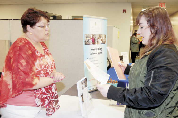 Sentinel photo by BUFFIE BOYER  Kasie Miller, right, of Lewistown, receives employment information about Keystone Human Services from Jeanne Schlager, a recruiter for the company, during the Job Fair sponsored by the  Juniata Valley Employer Advisory Council and MERF Radio Thursday at the Pennsylvania CareerLink Mifflin County. This year 47 different  employers participated in the event.