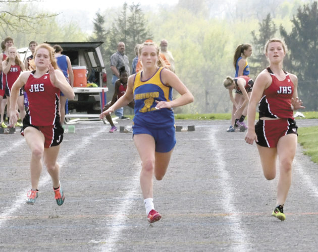 Sentinel photo by JEFF FISHBEIN   Juniata's Nylah Pannebaker, left, Greenwood's Paityn Wirth and Juniata's Ellie Shepps compete in the girls 100-meter dash at Greenwood Thursday.