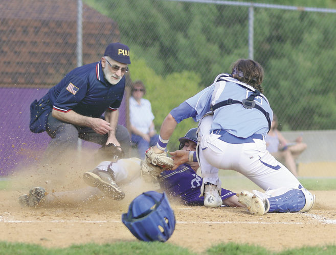 Sentinel photo by MATT STRICKER Mifflin County's Nick Hostetler is tagged out at home by Central Mountain catcher Bobby George Friday in Lewistown.