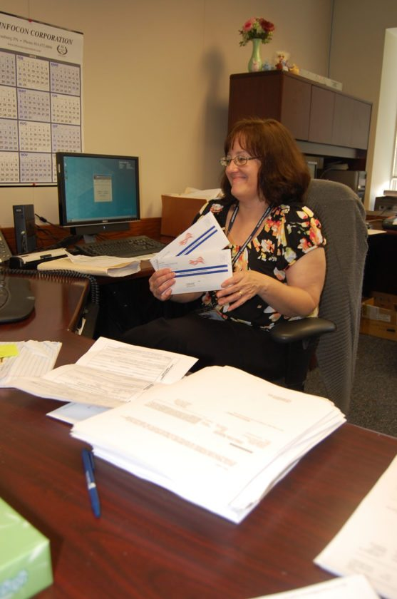 JIM RUNKLE/THE EXPRESS Clinton County Voter Registration Director Maria Boileau works in her office recently.