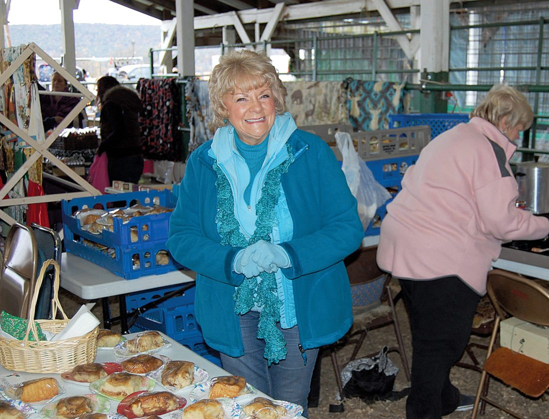 "Dawn Herlocher and the other ladies of the Mackeyville United Methodist Church offered their ""Famous Cinnamon Buns"" again this year at Christmas in the Barns, held Saturday and Sunday at the Clinton County Fairgrounds. The bakers take pride in the fact that they've always managed to sell out their tasty treats. This is the fourth year the group has participated in Christmas in the Barns."
