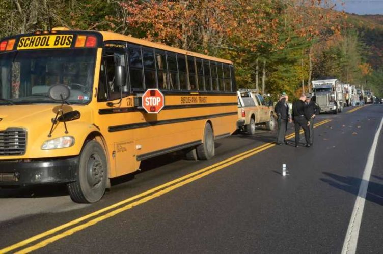 State police investigate at the scene of an accident this morning along Route 287 where a  year old girl was hit while crossing the road to get onto the bus, according to those at the scene.