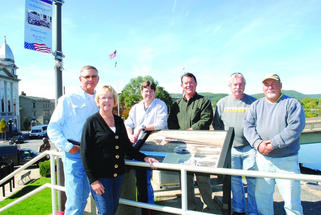 Jim and Carol Hanna who organized the interpretive panel project, stand with volunteers, from left, Lou Bernard, Lenny Long, Steve Getz and Levee Superintendent Gary Ferree.