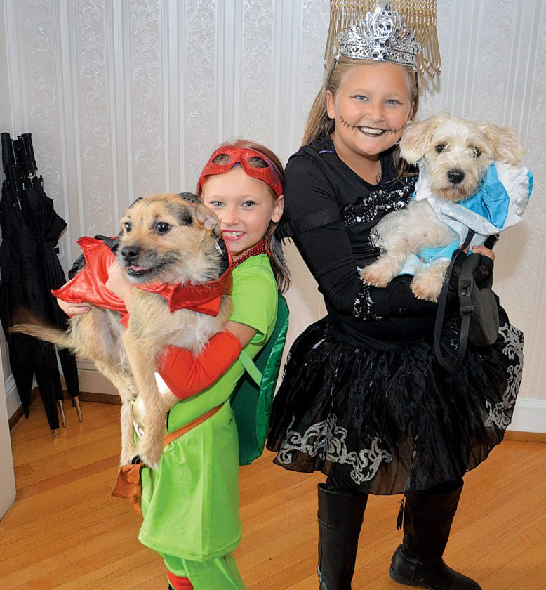 Peyton Lamey, left, age 9, of Jersey Shore, holds her dog Ruger, and Pirate princess Seneca Laubach, 10, holds her Maltese mix Blu.