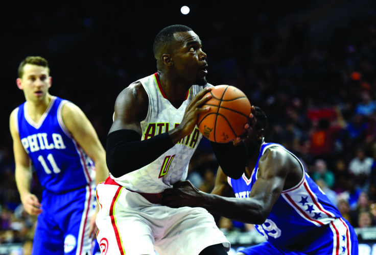 Atlanta Hawks' Paul Millsap (4) drives to the basket past Philadelphia 76ers' Jerami Grant (39) and Nik Stauskas (11) during the second half of an NBA basketball game, Saturday, Oct. 29, 2016, in Philadelphia. Millsap scored 17 points to lead five Hawks in double figures as Atlanta routed the 76ers 104-72. (AP Photo/Michael Perez)